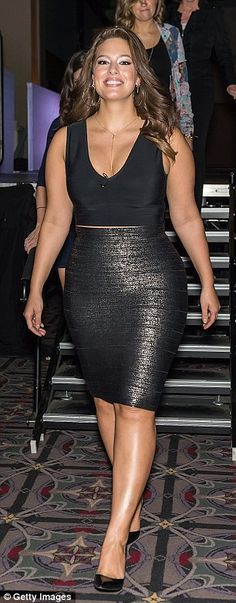 Figure-hugging: The brunette beauty showed some skin in a black crop top with a plunging neckline, which she teamed with a metallic pencil skirt which hugged her famous curves.
