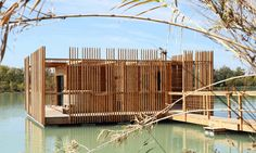 Completed in 2017 in Sorgues, France. Images by Marco Lavit Nicora. The Eco-hotel is located in a fishing reserve in Avignon, France. The 10 suites evoke primitive buildings on the shore of the lake; floating on the. Prefabricated Cabins, Prefab Homes, Modular Homes, Bora Bora, Avignon France, Floating Architecture, Architecture Design, Hotels In France, Prefab Buildings