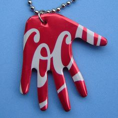 Pop Art Aluminum Can Hand Necklace-  I LOVE~LOVE~LOVE the sign language design here: http://www.flickr.com/photos/urbanwoodswalker/3254048555/in/photostream/