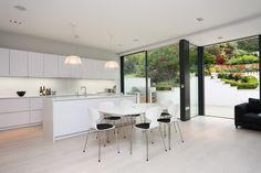 White kitchen ideas: Open plan, contemporary kitchen in a Polar white satin lacquer kitchen finish. #allwhitekitchen #contemporarykitchen #LWKKitchens