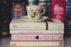 Comtesse du Chocolat - I should take one of these pictures...my cup of the day on my stack of reading