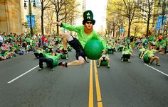 Photography of the Charlotte NC St. Patrick's Day Parade Image shows members of the Acrofitness of Charlotte group performing...The 18th Annual Charlotte St. Patrick's Day Parade will be held on 3/15/14 & steps off at 11:00am at 9th & Tryon St.