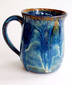 Mug by Linda Neubauer Pottery Blue Rutile x 4 with a bead of Coyote Red Gold on the rim
