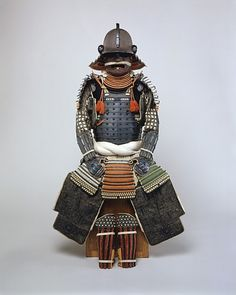 """Gusoku-Type Armor Japan, 18th century The Metropolitan Museum of Art """"The workmanship of this armor and its materials are all of the highest quality. It includes the kusazuri (skirt) with an extremely rare color scheme of silk lacings in red, yellowish-green, black, and white. The mon, in the form of three whirling commas (mitsudomoe mon) is that of the Okabe family, feudal lords of Kishiwada (present-day Kishiwada City, Osaka Prefecture). The armor is signed on the inside of the helmet: ..."""