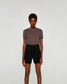 Image 1 of TOP WITH CONTRASTING PIPING from Zara
