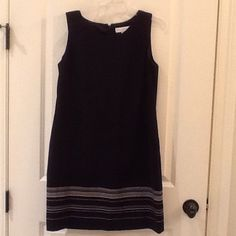 Petite Sophisticate- Black Dress Black sleeveless dress with white detailed accent on the bottom. Has a zipper going down the back with a little slit. Size: 10. Shell 100% polyester, lining 100% acetate. Great condition! Petite Sophisticate Dresses Midi