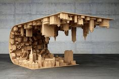 Mind-Bending Coffee Table Features Topsy-Turvy Cityscape Inspired By 'Inception' - DesignTAXI.com