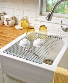 Drain and dry dishes over the sink with this Roll-Up Sink Drying Rack. It lets the water drip right into the sink. Can also be used to rinse and drain fruits or vegetables. Conveniently rolls up to st