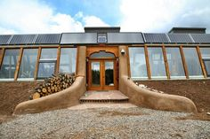 -Earthship- {Double doors like this in the middle of the center cylinder of house}