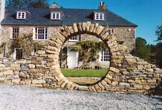 Stone moon gate is becoming more popular as a part of garden. Stone moon gate garden has a lot of different designs that you can use for your own garden Barn House Design, Gate Design, Building A Stone Wall, Jardin Decor, Moon Gate, Stone Masonry, Garden Arches, Dry Stone, Pole Barn Homes