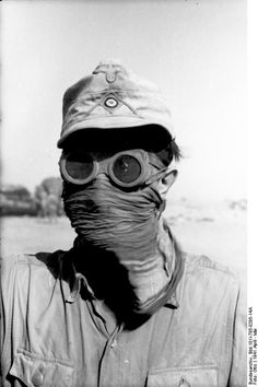 A German soldier of the Deutsches Afrikakorps protects his face and eyes with goggles and a scarf from desert sandstorms during the North African Campaign. April A German soldier of the German Soldiers Ww2, German Army, Afrika Corps, North African Campaign, German Uniforms, Ww2 Photos, Military Pictures, War Photography, Disney Marvel