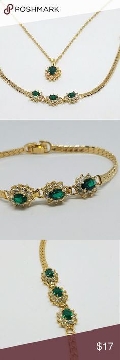 """Gold emerald green crystal necklace bracelet set emerald green rhinestone gold tone necklace & bracelet set is so gorgeous and is perfect for any look! well made with clear rhinestone surrounding geen sparkly rhinestones, a true statement piece.   Style: pendant necklace bracelet set  Color: gold green  Size: necklace 20"""" in length, bracelet approx. 7.5"""" Condition: like new, no missing stones  Approximate Date: 1990s Hallmarks/signature: none Jewelry Necklaces #emeraldbracelet"""