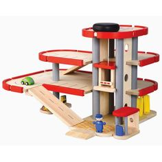 Plan Toys Wooden Parking Garage features three floors of parking space, an elevator tower that goes up and down, ramps, a gas pump, car wash and more! From eco-friendly PlanToys. Free Shipping!