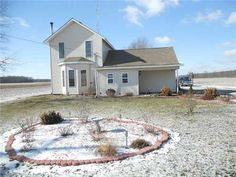 A VERY NICE UPDATED COUNTRY HOME. HOME HAS HAD MANY UPDATES IN THE PAST FEW YEARS. OPEN FLOOR PLAN WITH KITCHEN ISLAND AND NICE DINING ROOM. THE HOME ALSO HAS A WOODSTOVE FOR EXTRA HEAT SOURCE. LARGE BACK 10X28 DECK FOR SUMMER FUN. DETACHED 2 CAR GARAGE. HOME IS MOVE-IN READY in Ney OH
