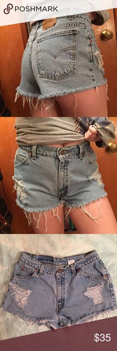 """Vintage Levi's High-Waisted Distressed Shorts! Vintage Levi's light/medium wash distressed high waisted cut off shorts! Fit like a size 8! Measurements include: waist-29"""", hip-38"""", inseam-1.5"""", rise-11"""", length from waist-11""""! These were cut at an angle and are super flattering and look amazing on! Perfect condition other than intentional distressing! Levi's Shorts Jean Shorts"""