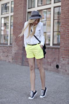 Love the hat, the dress shirt, the neon trousers, the skinny belt and the converse!