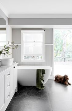Former Block contestants transform a heritage Queenslander home The Hamptons style bathroom is a family-friendly space where Murphy the mini labradoodle is also welcome. Hampton Style Bathrooms, Bathroom Styling, Bathroom Renovation, Bathroom Inspiration, Bathroom Decor, Bathroom Renos, Tile Bathroom, Bathroom Interior Design, Bathroom Design