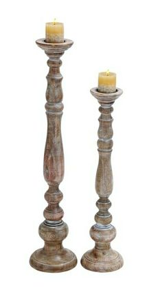 """Jasmine Wooden Candle Holder with Antiqued Finish - Set of 2. This set of two candle holders comes in the medium and a large size. They are made of high quality wood and are very beautifully designed. The best part about this set is that it resists corrosion. The exquisite design will surely lighten up your room beautifully.  The sturdy design of the stand provides a lot of stability to the candles. It is available in 2 size variants - 29"""" H x 7"""" W x 7"""" D, 36"""" H x 8"""" W x 8"""" D. SKU BZ14345"""