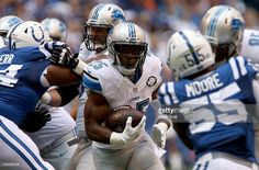 Detroit Lions' Theo Riddick #25 carries the ball past the line of scrimmage during the game between the Detroit Lions and the Indianapolis Colts at Lucas Oil Stadium on September 11, 2016 in Indianapolis, Indiana.
