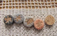 how to embroider on wine corks to make jewelry - i have a TON of corks that just might get used in this way soon!