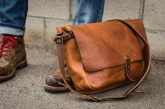 The Vintage Messenger is a tribute to antique postal bags, albeit an updated, leaner version that includes a suede-lined laptop compartment. The bag is constructed of 100% vegetable tanned leather and