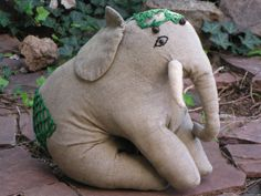 We could totally make this. I could sew the toy and you could make his head and back decoration.   Antique Stuffed Elephant 1940s Handsewn by BirdifactsOldandNew, $40.00