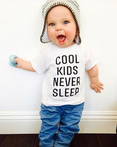 """Formerly @littlebeans_co on Instagram: """"""""Mom!!! Read the shirt! It says COOL KIDS NEVER SLEEP- therefore I'm not going to bed! Stop trying! Grab a coffee mom, it's going to be a long night! Mwhaha!"""" . Here's to hoping all our babes are NOT cool tonight and sleep! Thank you @thehudsonlegend for this amazing pic"""
