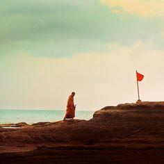 monk playing golf.