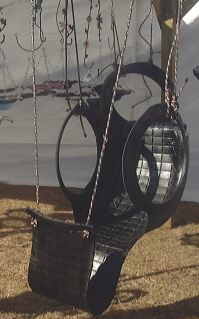 "www.tireswingsandgardenthings.com ""Hammock"" and chair swing out of tires. Cool!"