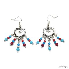 A personal favorite from my Etsy shop https://www.etsy.com/listing/248518320/antique-silver-red-and-turquoise