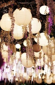 There is nothing more exciting that creating an atmosphere by hanging things from the ceiling. These lights and low hanging flowers look great.