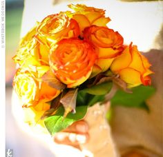 http://weddings.theknot.com/Real-Weddings/62545/detailview.aspx?type=3&id=62545&STOPREDIRECTING=TRUE&colors=Orange&Wedding%20Details=Bridesmaid%20Bouquets yellow and orange bouquet