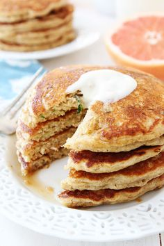 Whole Wheat Zucchini Pancakes Recipe on twopeasandtheirpod.com If you like zucchini bread you will LOVE these pancakes!