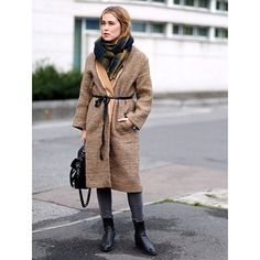 How Fashion People Prevent Frostbite #refinery29  http://www.refinery29.com/winter-outfit-ideas#slide15  Wrap yourself up in an oversized coat and tie it all together with a dainty ribbon belt.