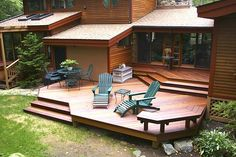 An Ipe hardwood deck with stylish levels, diagonal boards, built-in seating and wide, angular steps is handsome and efficient!