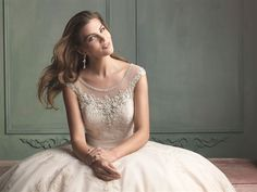 A perfect combination of lace and beadwork.  Give it a repin.  Available at www.gatewaybridal.com