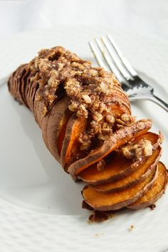 Cinnamon Brown Sugar Hasselback Sweet Potatoes with Oat Streusel Topping are the ultimate Thanksgiving sweet potato recipe. These stunning potatoes will impress with their beauty and flavor.