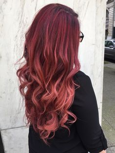Gorgeous red to pink balayage! Brighter is better for summer