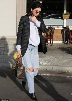 Kendall Jenner rocks ripped denim for lunch date | Daily Mail Online