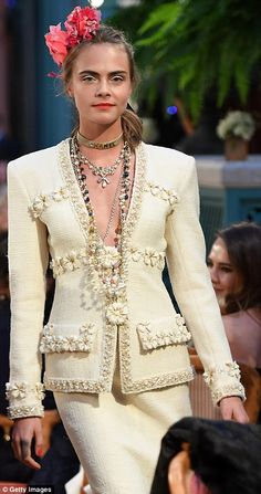 Classy in cream: Cara looked stunning in a textured suit with embroidered flower detail as...