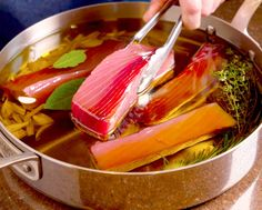 Olive Oil-Poached Tuna Provençal Recipe — Ingredients: 4 cups olive oil; 2 thyme sprigs; 2 rosemary sprigs;  4 bay leaves, preferably fresh;  1 head garlic, peeled;  1 1/2 pounds tuna fillet