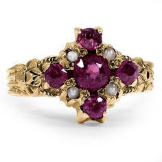 The Aminlai Ring.  This charming Victorian ring features five extraordinary garnets and four seed pearl accents in a romantic halo setting
