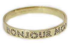 """Kate Spade New York """"Bonjour Monsieur"""" Idiom Bangle, Encrusted Crystal Lettering, Goldtone. take a peek: each of our iconic idiom bangles hides a witty turn of phrase that's married to the bangle's design with a whimsical nod and wink. inscription reads: bonjour monsieur in crystal. Inside engraved signature. Slips on. 2.5"""" diameter."""