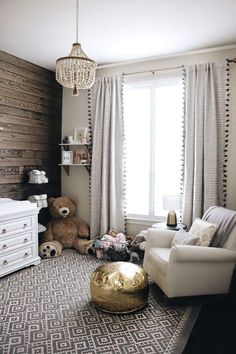 A gorgeous little girls nursery with beautiful furniture and that chandelier and curtains are so pretty!