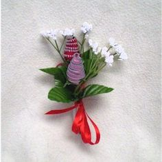 Supplies  Short zippers Red and Pink  Leftover small silk flowers  Hot Glue Gun  Ribbon  Tape    Instructions  Put a dab of hot glue at the tip of the zipper and begin to roll adding dabs of hot glue as you roll to hold the zipper in place.      Strip flower down to where only small baby's breath and leaves are left on the stem. On blank stem, attach zipper rose with hot glue     Tape stems together and decorate with ribbon of your choice.