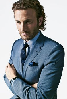 2012 Suits for Men - The New Rules of Suits - Esquire.  Fall 2012 Trends: blues (not just navy), pinstripes (suit, tie from Louis Vuitton)