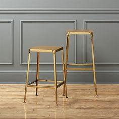 Factory-inspired stool parks square at the bar in flint steel with a glam gold finish and exposed welding. Legs flare refined, love those little capped feet. Each a handcrafted original.