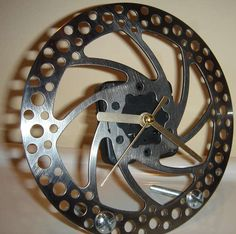 Instructables - make a clock out of a bicycle brake.  Or any other awesome stuff you have around the tool shed or garage.  A great gift idea for him!