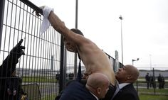 Staff storm board meeting at Charles de Gaulle airport and force executives to flee, with one clambering over fence half-naked