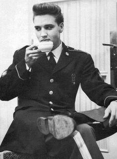 Elvis Presley & morning coffee -- I choose to believe this is tea.
